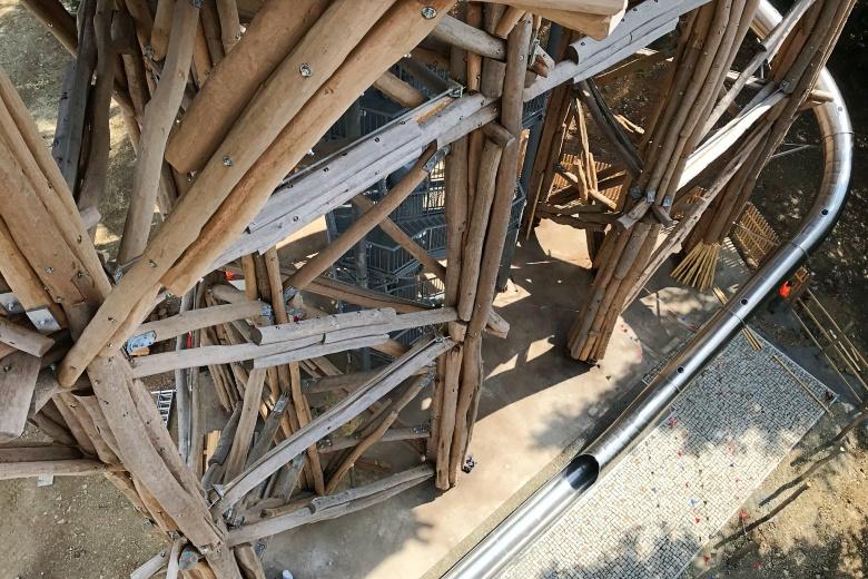 steel slide on wooden walking tower